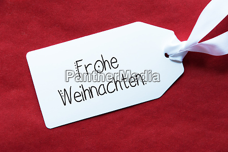 red background label frohe weihnachten means