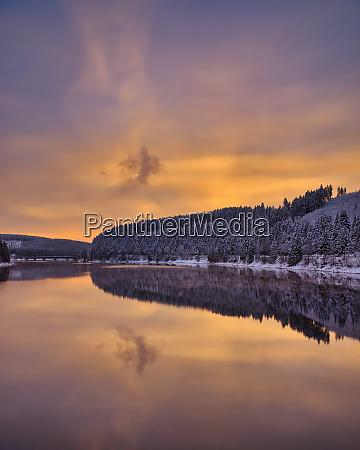 winter evening at okertalsperre reservoir in