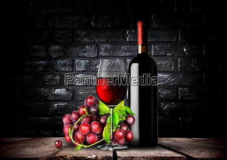 bottle red wine and grapes
