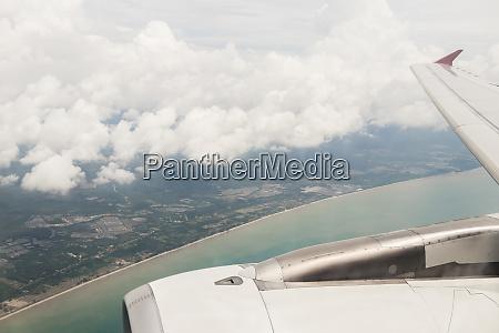 flight over surat thani blue water
