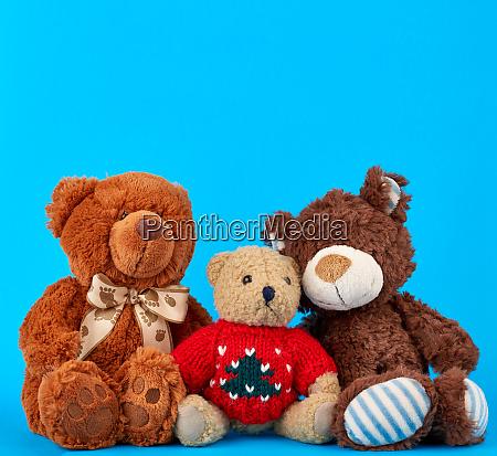 three teddy bears on a blue