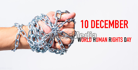 chained fist hands with 10 december