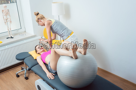 woman with physical therapist doing exercises
