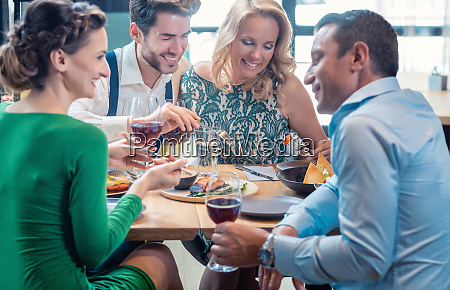friends in a restaurant having a