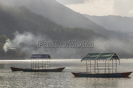 phewa fewa lake with fog smoke