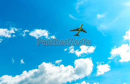 commercial airline flying on blue sky