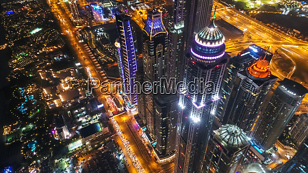 aerial view of illuminated skyscrapers at
