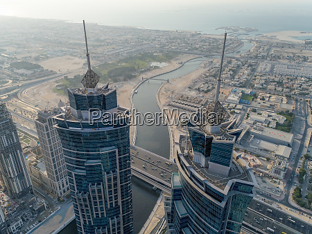 aerial view of skyscrapers and canal