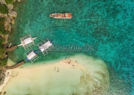 aerial view of beach pump boats
