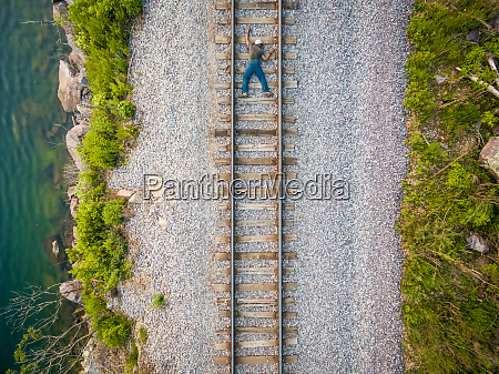concept aerial view man escalating rail