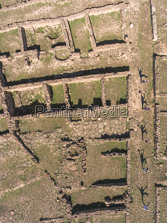 aerial view of workers shadows