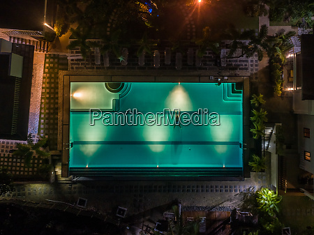 aerial night view of illuminated pool