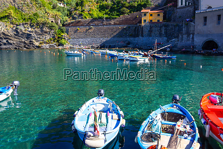 vernazza bay with colorful boats