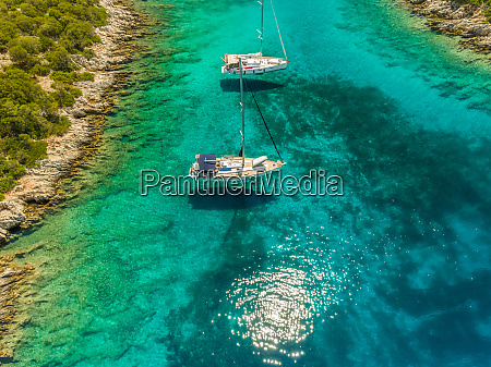 aerial view of two boats anchored