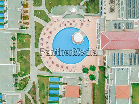 aerial view of tourists around swimming