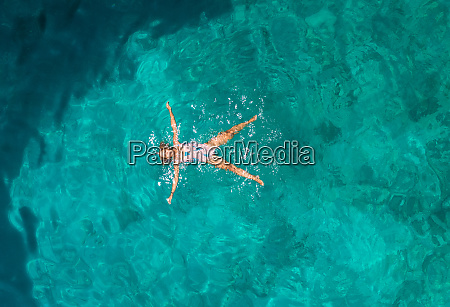 aerial, view, of, a, woman, floating - 27451606