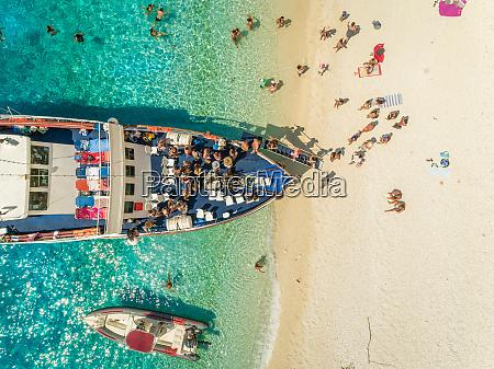 aerial view of people disembarking of