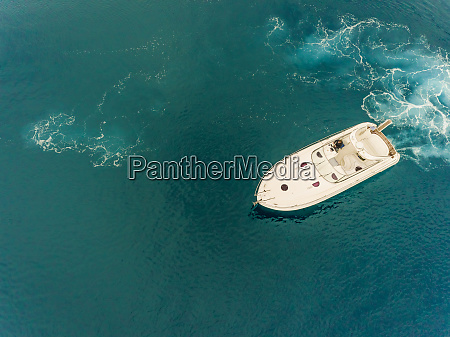 aerial view of man driving boat