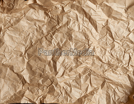 crumpled brown parchment baking paper full