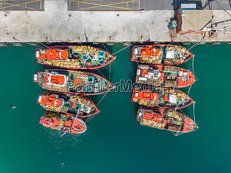 aerial view of eight fishing boats