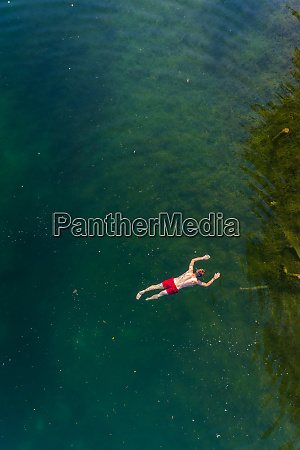 aerial view of man floating on