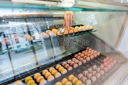confectioner shot through glass display in