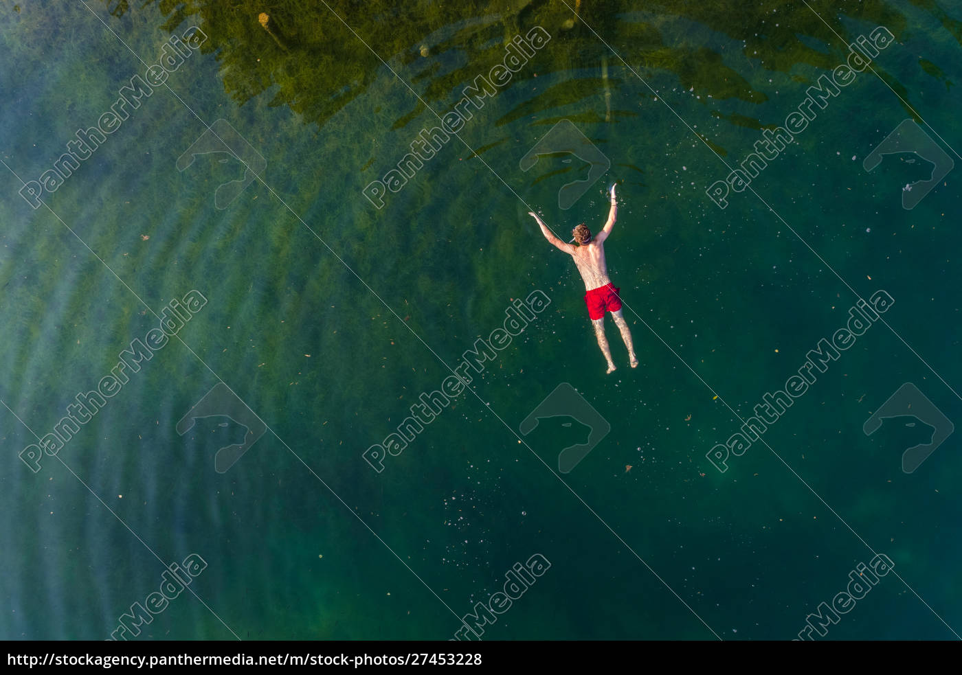 aerial, view, of, man, floating, on - 27453228