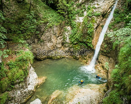 aerial view two men canyoning
