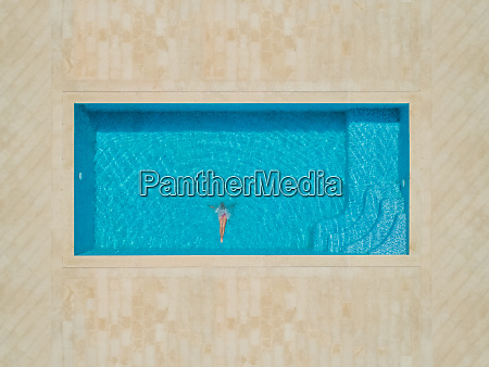 aerial view of girl diving into
