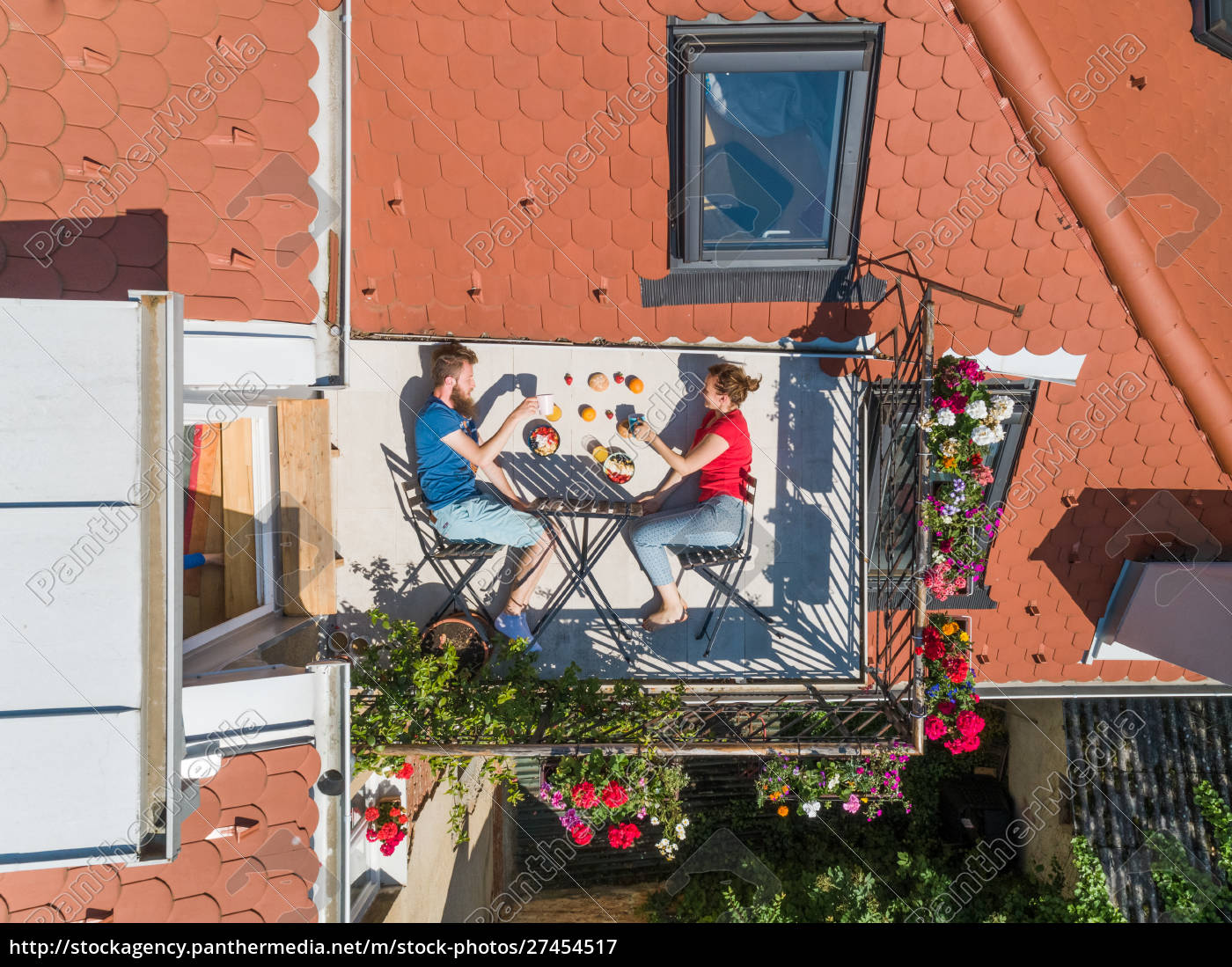 aerial, view, of, couple, having, breakfast - 27454517