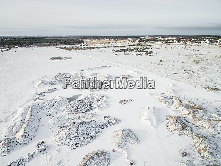aerial view of snowy countryside relief