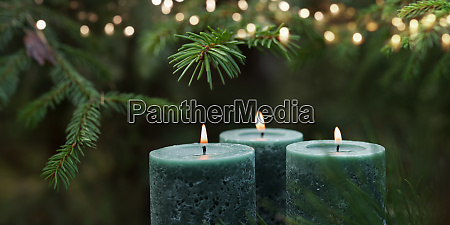 candles with christmas tree