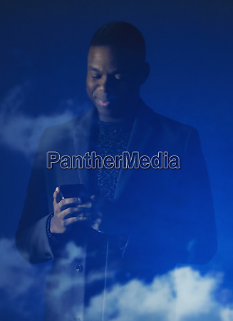 double exposure businessman using smart phone