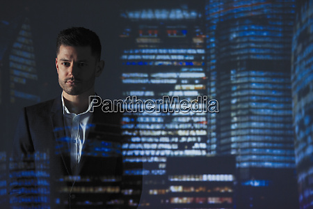 double exposure determined businessman against highrise