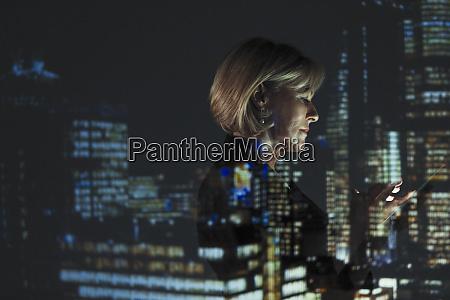 double exposure businesswoman using smart phone