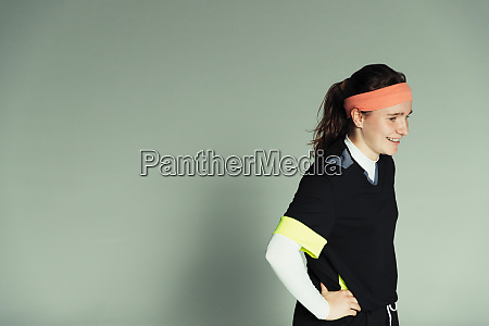 confident teenage girl soccer player with
