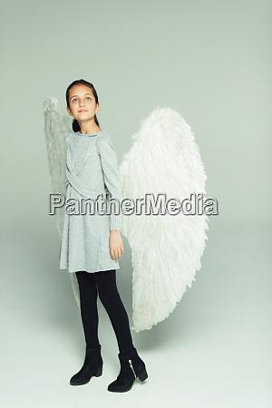 portrait hopeful ambitious girl wearing angel