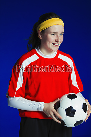portrait smiling teenage girl soccer player