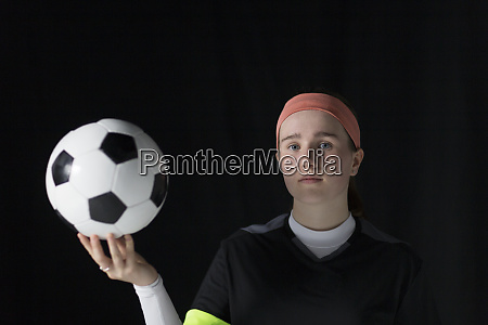 portrait confident determined teenage girl soccer