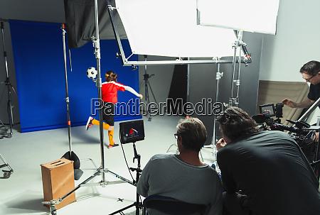 photographers and teenage girl soccer player