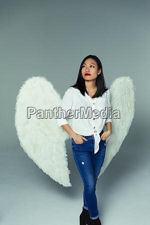 portrait serene thoughtful woman wearing angel