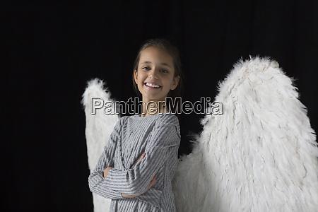 portrait smiling confident girl wearing angel
