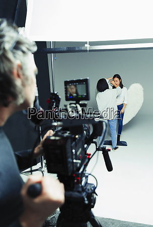 photographer waiting for makeup artist and