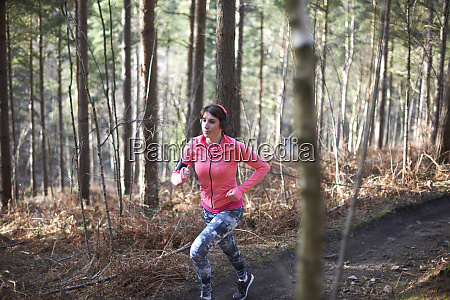 woman running on trail in autumn