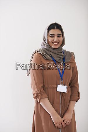 portrait confident teenage girl wearing hijab
