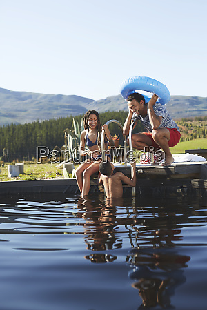 playful family swimming in sunny summer