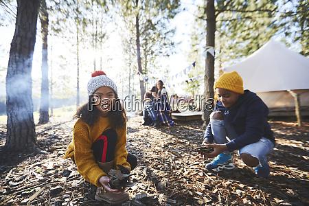 portrait smiling girl gathering kindling at