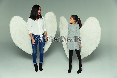 happy, mother, and, daughter, wearing, angel - 27457223