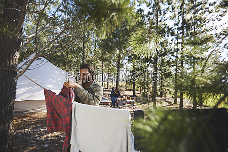man hanging laundry on clothesline at