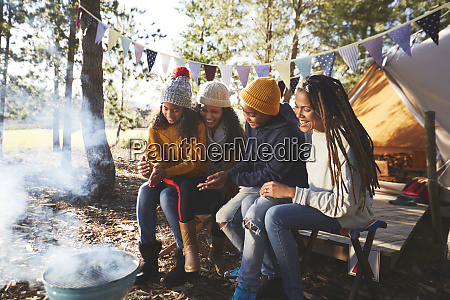 happy lesbian couple and kids relaxing